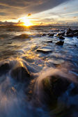 Waves, rocks and sunset at Borneo, Sabah, malaysia — Stock Photo