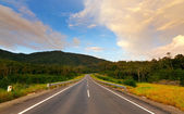 Road into hills with blue sky at Sabah,Borneo,Malaysia — Stock Photo