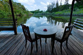 Table and chairs with lake view at Sabah, Malaysia — Stock Photo
