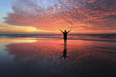 Silhouette of a man with sunset reflection at Sabah, Borneo, Malaysia — Stock Photo