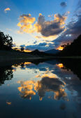 Reflection of sunset and clouds at Sabah, Borneo, Malaysia — Stock Photo