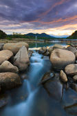 Sunset at a tropical river in Borneo, Sabah, Malaysia — Stock Photo