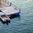Stock Photo: Boat and jetty on rippling waters