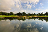 Reflection of sky at a golf course lake — Stock Photo