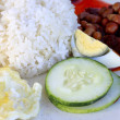Nasi lemak, a traditional malay curry paste rice dish — Stock Photo