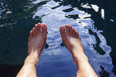 Male legs inside a pool — Stock Photo