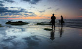 Silhouette of two photographers at sunset — Stock Photo