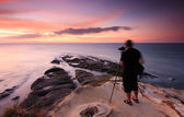 Long exposure coastal landscape and a photographer at the Tip of Borneo, Sabah, Malaysia — Stock Photo