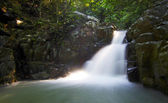 Tropical waterfall at a rainforest in Borneo — Stock Photo