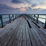 Broken wooden jetty at sunrise — Stock Photo #49281917