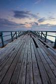 Broken wooden jetty at sunrise — Stock Photo