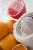 Orange and squeezer — Stock Photo