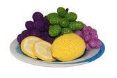 Knitted lemons and grapes on a plate — Stock Photo
