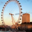 The London eye and Thames - Stock Photo