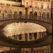 Stock Photo: Plaza de Espana in Sevilla at night, Spain. Panoramic reflected in the canal