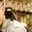 Stock Photo: Mwith monkey on his shoulder
