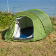 Green touristic tent near a sea by a sunny day — Stock Photo #38672049