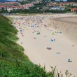 Beach of San Vicente de la Barquera village an d Oyambre Cape in Cantabria Spain — Stock Photo #38674333