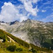 View through Alps valley near Gletch with Furka pass mountain ro — Stock Photo #39016705