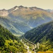 View through Alps valley near Gletch with Furka pass mountain ro — Stock Photo