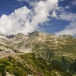 View through Alps valley near Gletch with Furka pass mountain ro — Stock Photo #39036915