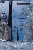 Ski chair lift with skiers. Ski resort in , navacerrada,spain — Stock Photo