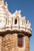 Barcelona park Guell fairy tale mosaic house on entrance — Stock Photo