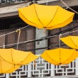 Street decorated with yellow umbrellas — Stock Photo