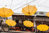 Street decorated with yellow umbrellas — Stockfoto