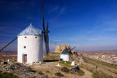 Cervantes Don Quixote windmills and Consuegra castle. Castile La — Stock Photo