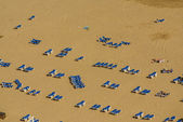 A group of sunbeds in the beach of Benidorm — Stock Photo