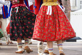 Horizontal colour image of female polish dancers in traditional  — Stock Photo