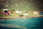 Typical Norwegian fishing village with traditional red rorbu hut — Стоковое фото