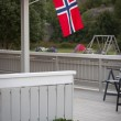 White house with flag in old part of Stavanger, Norway — Stock Photo #45779179