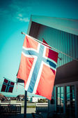 White house with flag in old part of Stavanger, Norway — Stock Photo