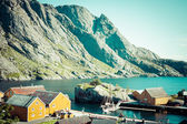 Red and yellow wooden fishing cabins in Norway — Stock Photo