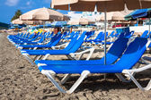 Deck chairs over the sand in a idyllic beach in Ibiza, Balearic — Stock Photo