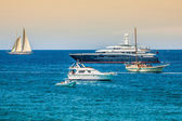 Luxury yachts in turquoise beach of Formentera Illetes — Stock Photo