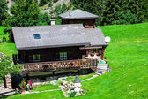Traditional country house in switzerlands alps — Stock Photo