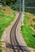 Railway in sunny day,Switzerland. It is classical railway. — Foto de Stock
