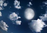 The moon in the night sky in clouds — Stock Photo
