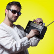 Young bearded man holding a vintage radio — Stock Photo