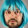 Funny bearded man with wig - Stock Photo