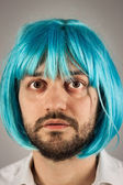 Funny bearded man with wig — Stock Photo