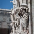 Statues on the facade of a church — 图库照片