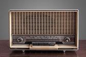 Vintage radio on grey background — Stock Photo