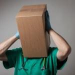 Doctor with cardboard box head — Stock Photo
