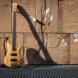 Bass guitar against a wall — Stock Photo