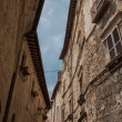 Upward view of old stone houses  — Stock Photo