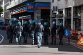 Riot police follows secondary school students protesting in Milan, Italy — Stock Photo